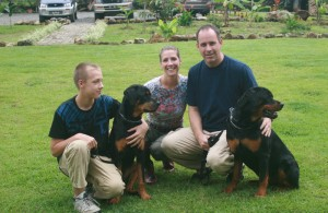 Family with a pair of Rottweilers